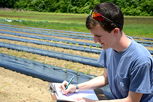Student taking notes in field