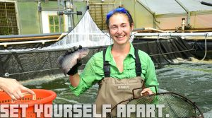 Smith holding fish, Set Yourself Apart